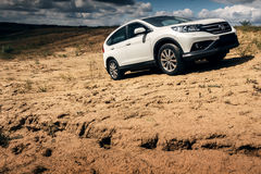 Car Honda CR-V stand at countryside road near forest at daytime Stock Photography