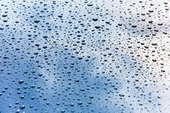 Car hood covered in small water drops macro stock photos