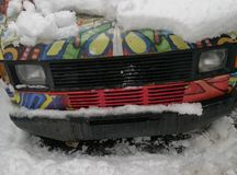 Car hood with headlights under the snow stock images