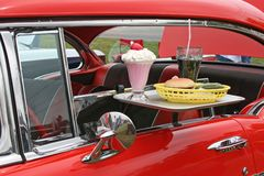 Car hop food and antique car. Tray of food on antique car brought by car hop Stock Photography