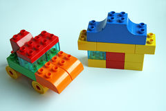 Car and the house. Toys (imitation of a car, house from the designer Royalty Free Stock Photo