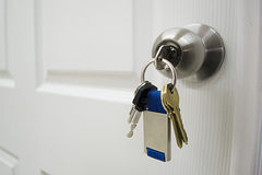Keys hanging from a house doorknob Stock Images