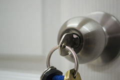 Keys hanging from a house doorknob Royalty Free Stock Image