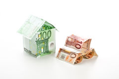 The car and the house made of euros Stock Image