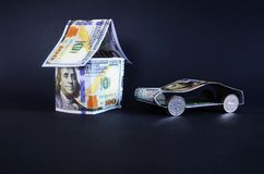 Car and house made of money. Royalty Free Stock Image