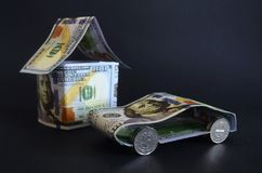 Car and house made of money. Stock Photography