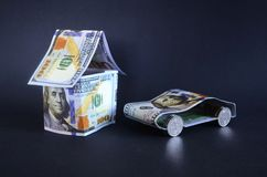 Car and house made of money. Royalty Free Stock Images