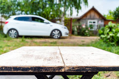Car and house in perspective background Royalty Free Stock Images