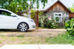 Car and house in perspective background Royalty Free Stock Photography