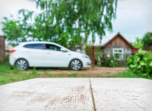 Car and house in perspective background Stock Image