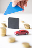 Car House and pile of coin. Royalty Free Stock Photos