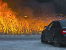 The car is about a huge dangerous fire stock photos