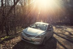 The car Hyundai Solaris Accent is parked in nature. Stock Photo