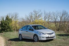 The car Hyundai Solaris Accent is parked in nature. Stock Photos