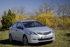 The car Hyundai Solaris Accent is parked in nature. Stock Images