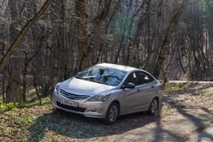 The car Hyundai Solaris Accent is parked in nature. Royalty Free Stock Image
