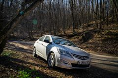 The car Hyundai Solaris Accent is parked in nature. Royalty Free Stock Photography