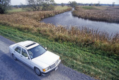 Car on I-90 in Montezuma National Wildlife Refuge, Seneca Falls, NY Stock Image