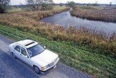 Car on I-90 in Montezuma National Wildlife Refuge, Seneca Falls, NY stock image