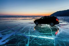 Car on the ice of Lake Baikal stock photography