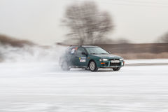 Car on ice in motion. Driving car on ice, winter frozen pond, panning shots. Russia, Moscow region Stock Photos