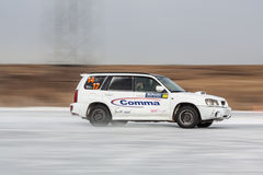 Car on ice in motion. Driving car on ice, winter frozen pond, panning shots. Russia, Moscow region Royalty Free Stock Images