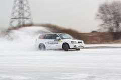 Car on ice in motion. Driving car on ice, winter frozen pond, panning shots. Russia, Moscow region Stock Images