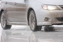 Car on ice with reflection. White car on ice with reflection Royalty Free Stock Image