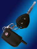 The car ignition key. оn a dark blue background Stock Photos