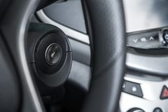 Car Ignition Keyhole. Modern Car Ignition Keyhole Closeup and Steering Wheel Royalty Free Stock Photo