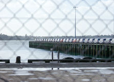 Car imports on wharf viewed through fencing at Auckland, New Zea Royalty Free Stock Photos