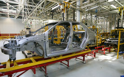 Car industry. There is a car assemblage at automobile factory stock photography