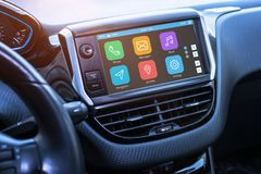 Car infotainment board display with apps. Modern car interior stock photos