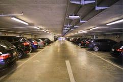 Cars inside underground parking garage Royalty Free Stock Photo