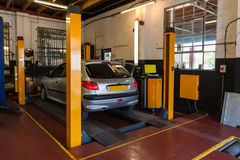 Car inspection. In automotive car service bays garage Royalty Free Stock Image