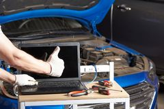 Car inspection garage mockup. Mechanic table with laptop and tools for maintenance service Royalty Free Stock Image