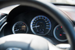 Car instrument panel dashboard automobile control illuminated panel speed display, close up and shallow depth of field Stock Image