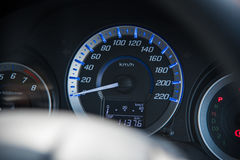Car instrument panel dashboard automobile control illuminated panel speed display, close up and shallow depth of field Royalty Free Stock Photos