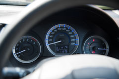 Car instrument panel dashboard automobile control illuminated panel speed display, close up and shallow depth of field Stock Images