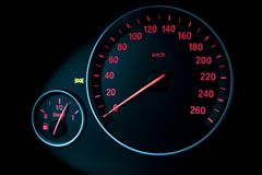 Car instrument panel, dashboard closeup with visible speedometer and fuel level. Modern car interior details. Car instrument panel, dashboard closeup with royalty free stock photos