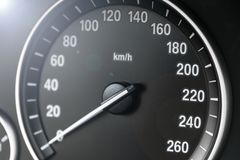 Car instrument panel dashboard closeup with visible speedometer, car interior details. Soft lighting. Royalty Free Stock Images