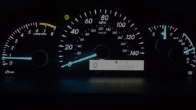 Car instrument panel (22222 miles). Illuminated in the night. Royalty Free Stock Photography