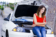 Car insurance. Woman by her car waits for help Stock Photography