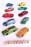 Car insurance. Toy cars isolated on white, concept for car insurance Stock Image