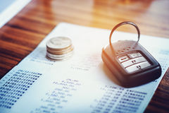 Car insurance,Car remote and account book in finance and banking Stock Image