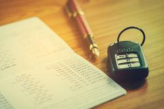 Car insurance,Car remote and account book in finance and banking Stock Images
