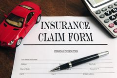 Car  insurance claim form on desk Stock Photos