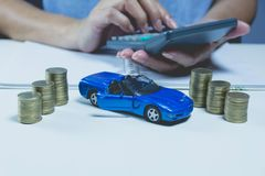 Car insurance with coins and car services concept. Business Stock Images