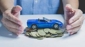 Car insurance with coins and car services concept. Business Stock Photos