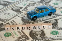 Car insurance concept. Paying lots of money to get your car insured Royalty Free Stock Photography